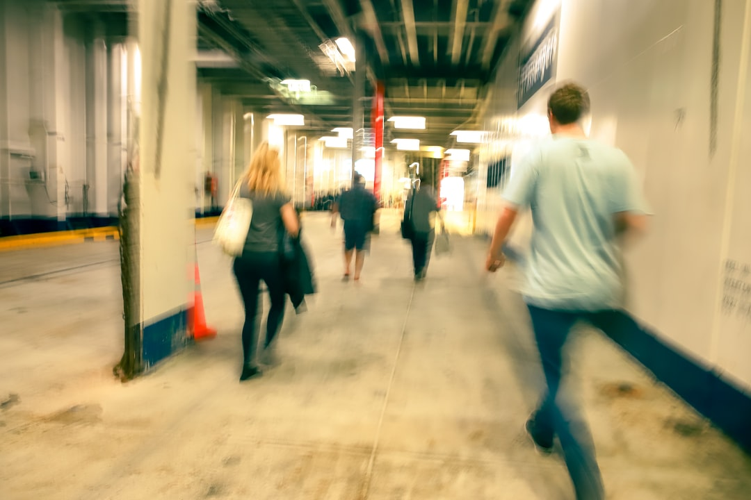 A group of people walking on the floor